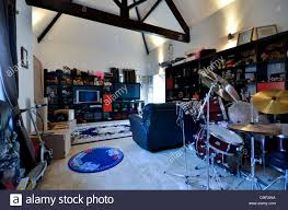 teenagers play room with drum kit tv and games consoles stock
