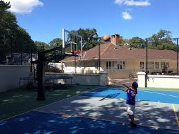 a young kid is working on his mid range shot