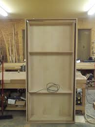 Hideaway Cabinet Doors by Hidden Pivot Bookcase Installation Thisiscarpentry