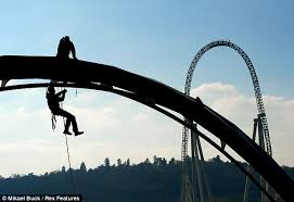 engineers inspect rollercoasters at thorpe park while suspended
