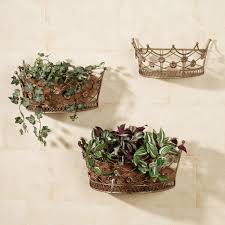 bronze metal wall mounted basket planter with floral ornament with