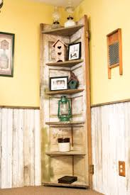 a old door made into a rustic corner shelf for my kitchen