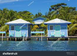 overwater bungalows palm trees background bocas stock photo