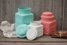 mint green and coral kitchen canister set from the vintage