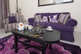 dark purple living room ideas stained wooden wall cream fabric
