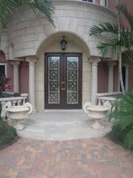 impact glass entry doors handmade entry doors with custom stained glass panels behind