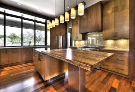 wood countertop chrome simple chandelier beige tile ceramic
