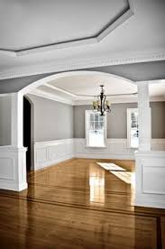 Interior Molding Designs by Two Tone Wall With Chair Rail And Dark Hardwood Dining Room