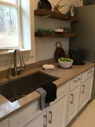 beige eco friendly quartz countertop with white cabinet using open