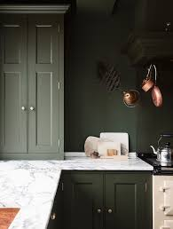 bored of white kitchens discover the cabinet color trending now