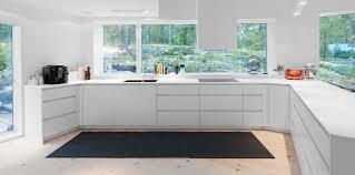 fine modern kitchen flooring features dark flat front cabinets