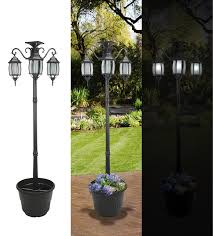 Patio Torch Lights by Amazon Com Sunergy 50408190 Madison Solar Lamp Post And Planter