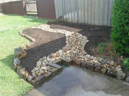 ideas using river rock flower bed with moss rock and rainbow