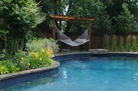 contemporary hammock chair stands pool tropical with decking