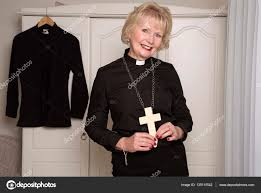 religious dressed in black holding a cross stock photo