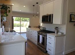 white shaker kitchen cabinets backsplash white brass boho chic kitchen west oaks construction