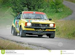 opel kadett rally car unidentified drivers on a yellow vintage opel kadett c coupe