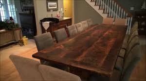 reclaimed wood trestle tables finished with epoxy by hd threshing