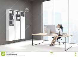 woman ceo in office with bookshelves and computer stock