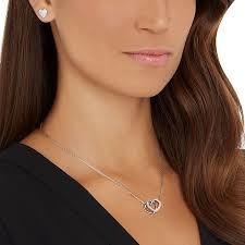 two earrings buy online swarovski dear set with a sleek entwined heart design