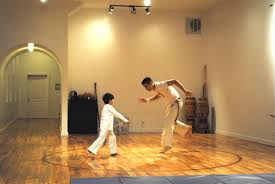 the musical martial art capoeira where you get serenaded while