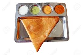 appetizing and delicious triangular indian masala dosa in golden