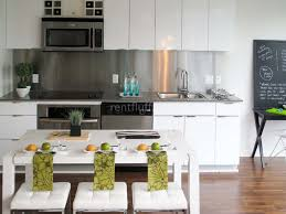 stainless steel backsplashes for kitchens small kitchen designed with white modern cabinets and protected