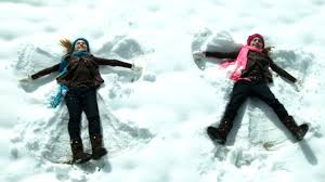 twin girls making snow angels youtube