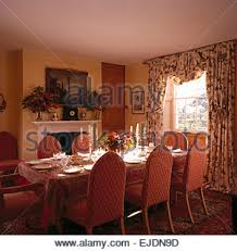 Gothic Dining Room Table by Upholstered Chairs And Table Set For Lunch In Front Of Tall Gothic