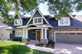 blue house white trim front door stone veneer siding exterior traditional with blue house carriage