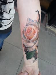 realistic white rose tattoo on forearm by sarahmiller