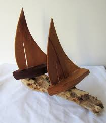 carved wooden ornamental sailing boats nautical and
