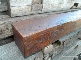 sawn barn beam mantel with worm trails dark stain antique woodworks