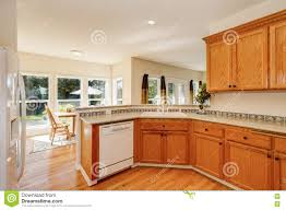 White Kitchen Cabinets White Appliances by Light Brown Kitchen Cabinets And White Appliances Stock Photo