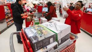 target sales during black friday 2014 target raises minimum hourly wage to 11 pledges 15 by end of