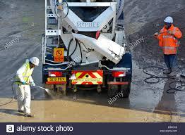 ready mix concrete cement mixer truck reversing towards public