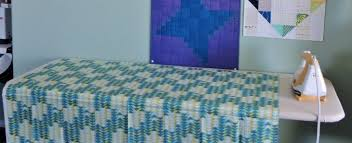 quilting ironing board table creative ironing board ideas for your work space the sewing loft