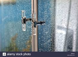 shower cubicle door handles with water droplets stock photo