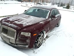 roll royce road rolls royce ghost in a snow storm is quite interesting business