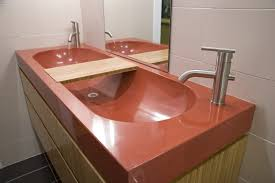double brown glossy concrete sink and steel faucet over brown