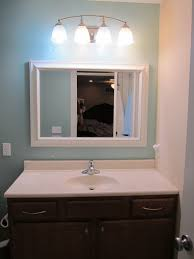 brown and blue bathroom ideas gray wall paint mirror wooden frame dark brown real wood vanity