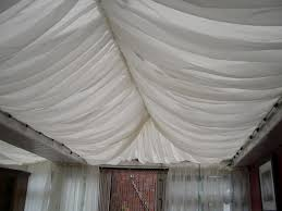 voile curtain attached to conservatory roof for the moroccan tent