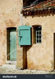 beautiful funny yellow house turquoise doors stock photo 95314480