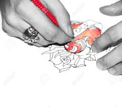 red pencil tattoo artists use why do tattoo artists use red