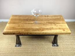 simple round glass dining table with walnut wood legs of