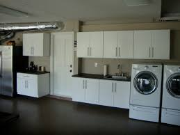 wall mounted cabinets for laundry room garage closets cabinets traditional laundry room orange