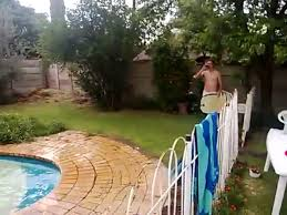 man rides boogie board on pool while drinking beer jukin media