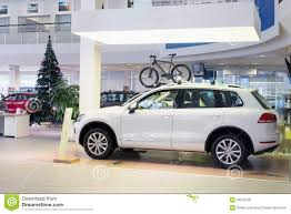 volkswagen christmas hall with cars and the christmas tree editorial stock photo