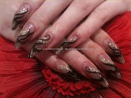 stiletto nails with gold glitter and freehand nail art stiletto