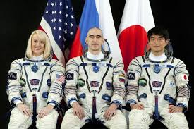 iss crew trio launched safely into orbit for test drive of